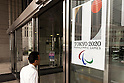 A man walks past a Tokyo 2020 Paralympic Games logo on display at the entrance of Tokyo Metropolitan building on September 1, 2015, Tokyo, Japan. The Tokyo Olympic organizers have decided to drop the logo for the 2020 Games after an emergency meeting on Tuesday September 1st. Designer Kenjiro Sano's logo had been critized after Belgian, Olivier Debie, instigated legal action due to similarities to his logo for the Theater de Liege in Belgium. Beleaguered Sano has also recently faced other questions of plagiarism over his past designs. (Photo by Rodrigo Reyes Marin/AFLO)