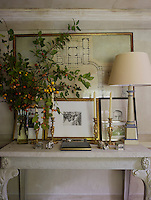 The plans for Waterloo Palace by James Wyatt hang behind works by Lucian Freud, Graham Sutherland and David Hockney on a marble-topped console table