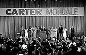 "United States President-elect Jimmy Carter, surrounded by family, claims victory over US President Gerald R. Ford at an election night rally in Atlanta, Georgia on November 3, 1976.  <br /> Credit: Benjamin E. ""Gene"" Forte / CNP"