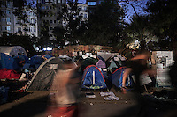 In this Saturday, Jun. 08, 2013 photo, protesters pass by in front on tents as dawn rises up in Gazi park of Taksim Square during a 24/7 masive rally against the turkish government in Istanbul, Turkey. (Photo/Narciso Contreras).