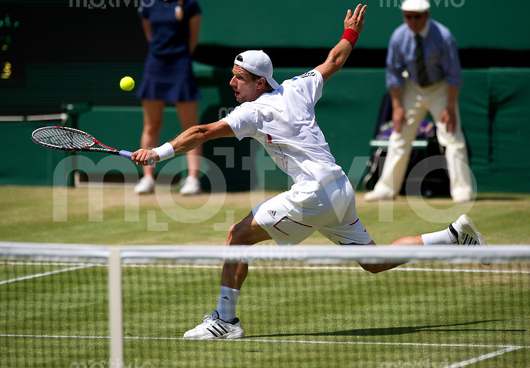 Juergen Melzer (AUT) plays against Roger Federer (SUI) on Centre Court. The Wimbledon Championships 2010 The All England Lawn Tennis & Croquet Club  Day 7 Monday 28/06/2010