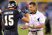 20 December 2011:  FIU Head Football Coach Mario Cristobal attempts to fire up tight end Colt Anderson (15) prior to the game.  The Marshall University Thundering Herd defeated the FIU Golden Panthers, 20-10, to win the Beef 'O'Brady's St. Petersburg Bowl at Tropicana Field in St. Petersburg, Florida.