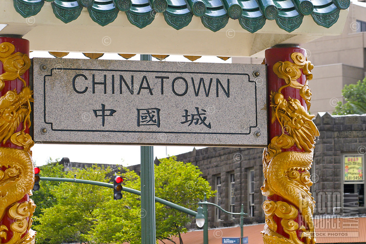 This marble sign written in both english and chinese welcomes all visitors to the scenic and historic Chinatown area of downtown Honolulu.
