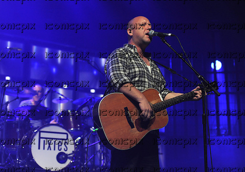 PIXIES - drummer David Lovering and vocalist Black Francis - performing live on Day 25 of the iTunes Festival at The Roundhouse in London UK - 25 Sep 2013.  Photo credit: George Chin/IconicPix