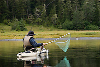 Kayak fishing for Silver salmon (Coho) in the Valdez, Alaska area of south central Alaska with Pacific Mountain Guides outfitter Otto Kulm. Fishing was done in both salt water and fresh water in the Prince William Sound region.