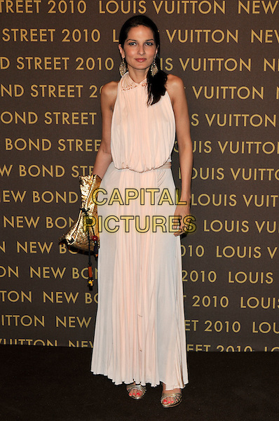 GUEST .attends the launch of the Louis Vuitton Bond Street Maison Store in London, England, UK, May 25th, 2010. .full length sleeveless cream peach nude long maxi dress gold clutch bag open toe shoes sandals .CAP/PL.©Phil Loftus/Capital Pictures.