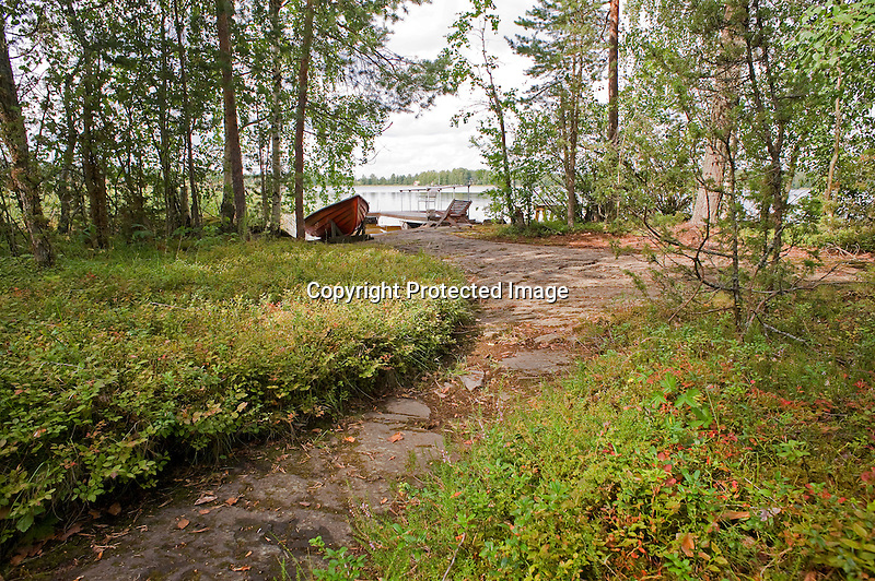 Cottage Path to Rowboat and Lake during Finland Summer