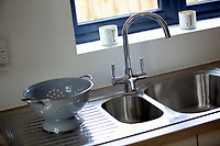 Pictured: A calender and the kitchen tap and sink Wednesday 26 April 2017<br /> Re: Waterstone Homes' most recent property development Howell's Reach, is in Derwen Fawr, Swansea and is made up of 13 luxury family homes, and also includes five affordable homes.