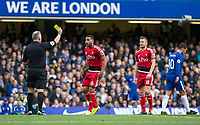 Adrian Mariappa of Watford shows surprise at being handed a yellow card during the Premier League match between Chelsea and Watford at Stamford Bridge, London, England on 21 October 2017. Photo by Andy Rowland.
