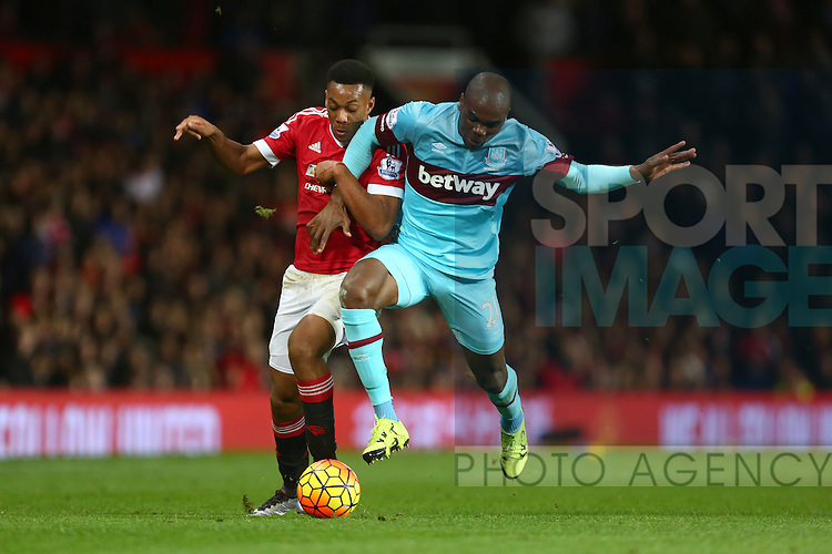 Anthony Martial of Manchester United battles West Ham's Angelo Ogbonna - Manchester United vs West Ham United - Barclay's Premier League - Old Trafford - Manchester - 05/12/2015 Pic Philip Oldham/SportImage