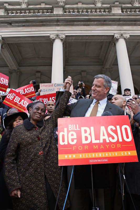 New York City Public Advocate and the democratic mayoral candidate Bill de Blasio, joined by his wife Chirlane McCray, makes a campaign stop at a rally organized by New York City Latino elected officials on the steps of City Hall, Manhattan, NY.  Those in attendance included Bronx Borough president Ruben Diaz Jr, Congresswoman Nydia Velázquez, Congressman Jose Serrano, as well as actress Rosie Perez and musician Willie Colon.