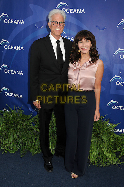 Ted Danson &amp; Mary Steenburgen<br /> 6th Annual Oceana SeaChange Gala held at a Private Villa, Laguna Beach, California, USA. <br /> August 18th, 2013<br /> full length black suit glasses pink silk satin sleeveless top blouse blue trousers married husband wife <br /> CAP/ADM/BP<br /> &copy;Byron Purvis/AdMedia/Capital Pictures