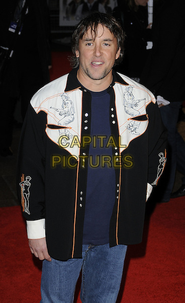 RICHARD LINKLATER.'Me & Orson Welles' UK film premiere at the Vue West End, Leicester Sqaure, London, England.November 18th, 2009.half length white black cowboy blue t-shirt shirt jacket drawings orange trim director mouth open.CAP/CAN.©Can Nguyen/Capital Pictures.