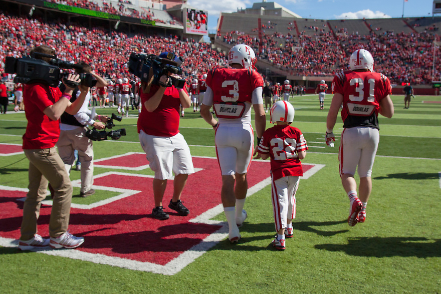 April 06, 2013: Taylor Martinez #3 walks Jack Hollman off the field after Jack scores a touchdown for the Red team during Red-White spring game at Memorial Stadium in Lincoln, Nebraska. The Red team defeated the White team 30 to 21.