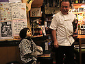 "October 22, 2016, Utsunomiya, Japan - A Japanese macaque Fuku (meaning happiness) wearing a female mask helps an izakaya, Japanese pub ""Kayabuki"" in Utsunomiya, 100km north of Tokyo on Saturday, October 22, 2016. The pub master Kaoru Otsuka trains Japanese macaques to help him and show their entertainment skills to attract customers including lots of foreign tourists.   (Photo by Yoshio Tsunoda/AFLO) LWX -ytd-"
