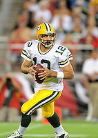 Aug. 28, 2009; Glendale, AZ, USA; Green Bay Packers quarterback (12) Aaron Rodgers in the first half against the Arizona Cardinals during a preseason game at University of Phoenix Stadium. Mandatory Credit: Mark J. Rebilas-