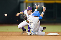 LSU Tiger shortstop Alex Bregman (30) catches the throw from the catcher as UCLA runner Kevin Williams (5) steals second base during Game 4 of the 2013 Men's College World Series against the UCLA Bruins on June 16, 2013 at TD Ameritrade Park in Omaha, Nebraska. UCLA defeated LSU 2-1. (Andrew Woolley/Four Seam Images)
