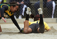 Charlotte Pointon dives for home base but is tagged out by Hutt Valley pitcher Ali Manley during round two of the National Women's Softball Championships at Hataitai Park, Wellington, NewZealand on Sunday 2 February 2009. Photo: Dave Lintott / lintottphoto.co.nz