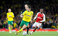 Nelson Oliveira of Norwich City moves from Edward 'Eddie'  Nketiah of Arsenal during the Carabao Cup match between Arsenal and Norwich City at the Emirates Stadium, London, England on 24 October 2017. Photo by Carlton Myrie.