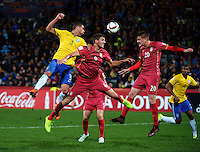 Brazil's Lucao (left) competes with Serbia's Srdan Babic (6) and Sergej Milinkovic (20) for a header during the FIFA Under-20 Football World Cup Final between Brazil (gold) and Serbia at North Harbour Stadium, Albany, New Zealand on Saturday, 20 June 2015. Photo: Dave Lintott / lintottphoto.co.nz