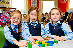 Abbie McCarthy, Elsa Daly and Alannah Casey on their first day at school in Faha NS on Tuesday