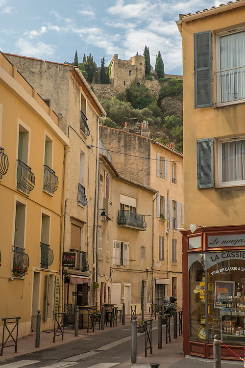 The early morning streets of harbor-side Cassis await the tourists drawn to this spectacular section of French coastline.