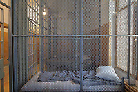 Woman's cell (women's cells were separated by metal grills), in the Vieille Prison de Trois Rivieres, or Old Prison, built 1816-22 in Palladian style by Francois Baillairge, and used as a jail 1822-1986, now the Quebec Museum of Popular Culture, in Trois-Rivieres, Mauricie, on the Chemin du Roi, Quebec, Canada. The Chemin du Roy or King's Highway is a historic road along the Saint Lawrence river built 1731-37, connecting communities between Quebec City and Montreal. Picture by Manuel Cohen