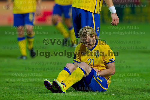 Sweden's Christian Wilhelmsson (C) grimmaces in pain during the UEFA EURO 2012 Group E qualifier Hungary playing against Sweden in Budapest, Hungary on September 02, 2011. ATTILA VOLGYI