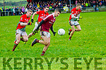 Dromids Dylan O'Donoghue makes a run but is closely chaperoned by St Michaels/Foilmore's Sean O'Sullivan, D.J.Moran & Padraig King.