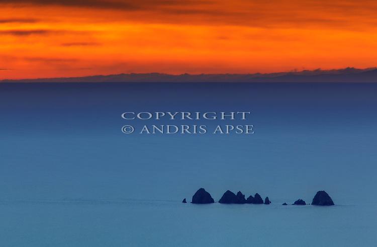 Sunrise over the Jag Rocks from D'Urville Island. Marlborough Region. New Zealand.