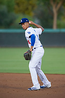 AZL Dodgers second baseman Marcus Chiu (14) prepares to make a throw to first base against the AZL Brewers on July 25, 2017 at Camelback Ranch in Glendale, Arizona. AZL Dodgers defeated the AZL Brewers 8-3. (Zachary Lucy/Four Seam Images)