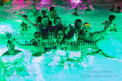 Revellers dance in the thermal water during a night bath in Budapest, Hungary on June 30, 2012. ATTILA VOLGYI