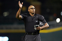 Home plate umpire Jose Navas signals a pitching change to the press box during the International League game between the Scranton/Wilkes-Barre RailRiders and the Charlotte Knights at BB&T BallPark on August 14, 2019 in Charlotte, North Carolina. The Knights defeated the RailRiders 13-12 in ten innings. (Brian Westerholt/Four Seam Images)