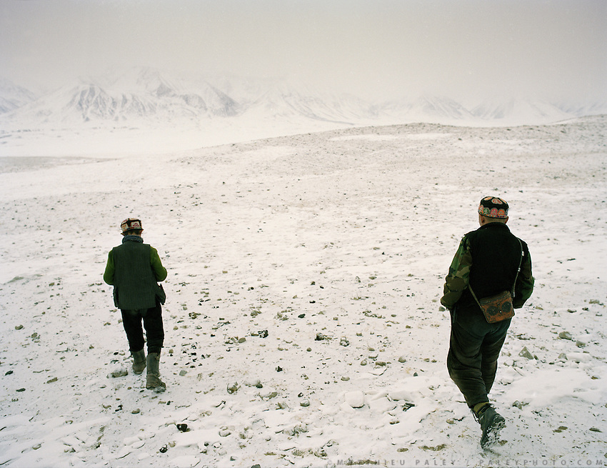 "Ghulam Ustad's sons looking for their sheep herd's return..Campment of the ""second"" Sary Tash. Ustad's Ghulam's camp..Winter expedition through the Wakhan Corridor and into the Afghan Pamir mountains, to document the life of the Afghan Kyrgyz tribe. January/February 2008. Afghanistan"