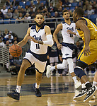 Nevada Cody Martin (11) brings the ball up the floor against California Baptist in the first half of an NCAA college basketball game in Reno, Nev., Friday, Nov. 16, 2018. (AP Photo/Tom R. Smedes)
