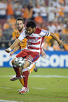 FC Dallas forward Carlos Ruiz strikes the ball for the goal in the 14th minute during the second leg of the Western Conference Semifinal Series at Robertson Stadium in Houston, TX on November 2, 2007