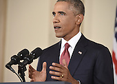 US President Barack Obama speaks during a primetime address to the nation from the Cross Hall of the White House in Washington, DC, September 10, 2014. <br /> Credit: Saul Loeb / Pool via CNP