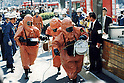 Members of a special chemical accident response team of the Tokyo Fire Department wearing gas masks and protective clothing enter Kasumigaseki Subway Station in Chiyoda-ku, Tokyo on March 20th, 1995. At around 8.00am in the morning members of the Aum Shirikyo Doomsday Cult released poisonous Sarin Gas in five coordinated attacks on trains travelling through Kasumigaseki and Nagatacho stations. This resulted in the death of 13 passengers and staff and over 6,000 injuries and was Japan's deadliest act of domestic terrorism.  (Photo by Mainichi Newspapers/AFLO)