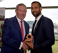 Graham Gooch (L) presents Varun Chopra (R) with his County Championship winning medal during the Lord's Taverners Presentation at Lord's Cricket Ground on 12th March 2018