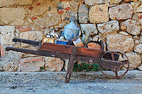 Small wagon carrying kitchen utensils, Monteriggioni, Italy, Tuscany