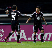 Jaime Moreno (99) of D.C. United celebrates a goal with teammate Santino Quaranta (25) during the game at RFK Stadium in Washington, DC.  Toronto defeated D.C. United, 3-2.