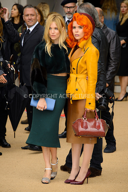 WWW.ACEPIXS.COM<br /> <br /> US Sales Only<br /> <br /> September 16 2013, London<br /> <br /> Sienna Miller and Paloma Faith arriving at the Burberry Prorsum show at London Fashion Week SS14 at Kensington Gardens on September 16, 2013 in London, England<br /> <br /> ACE Pictures, Inc.<br /> tel: 646 769 0430<br /> Email: info@acepixs.com<br /> www.acepixs.com