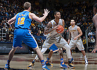 Richard Solomon of California controls the ball during the game against UCLA at Haas Pavilion in Berkeley, California on February 19th, 2014.  UCLA defeated California, 86-66.