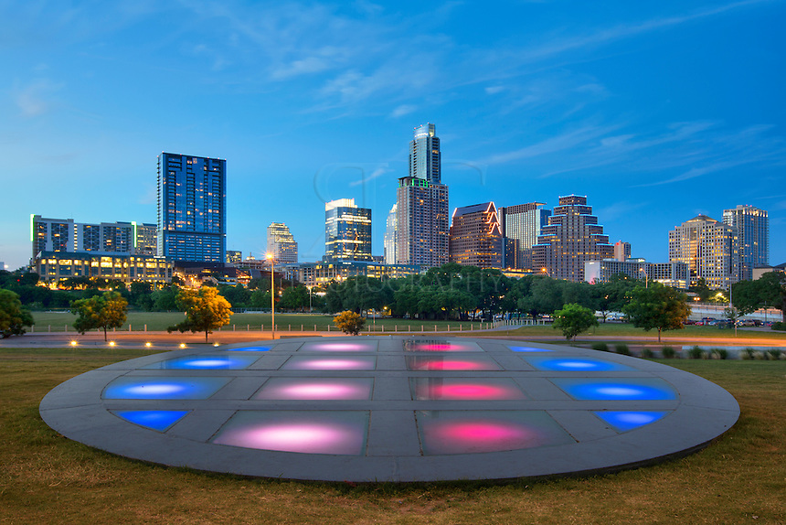 Just beyond the pavillion at the Long Center, the Austin skyline begins to glow in the twilight of a summer evening.