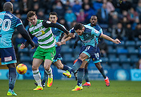 Sam Wood of Wycombe Wanderers takes a shot past Matt Butcher of Yeovil Town during the Sky Bet League 2 match between Wycombe Wanderers and Yeovil Town at Adams Park, High Wycombe, England on 14 January 2017. Photo by Andy Rowland / PRiME Media Images.