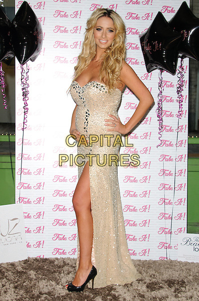 Chantelle Houghton.Glamour model and reality TV star launches her false eyelashes range, Fake It!, The Beauty Shop, Kingly Court, London, England..December 13th, 2011.full length gold cream beads beaded embellished jewel encrusted strapless slit split dress silver pregnant hand on hip black peep toe shoes side.CAP/CJ.©Chris Joseph/Capital Pictures.