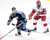 Jon Jankus, Matt Olinger - The University of Wisconsin Badgers defeated the University of Maine Black Bears 5-2 in their 2006 Frozen Four Semi-Final meeting on Thursday, April 6, 2006, at the Bradley Center in Milwaukee, Wisconsin.  Wisconsin would go on to win the Title on April 8, 2006.