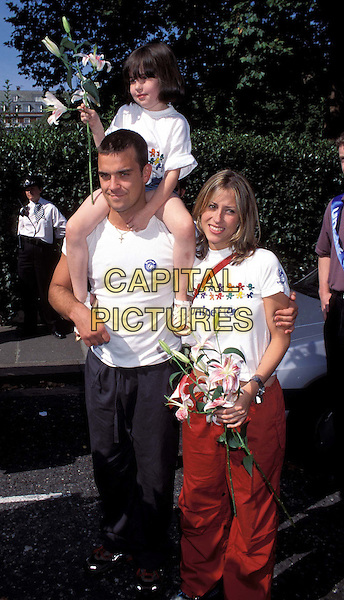 ROBBIE WILLIAMS & NICOLE APPLETON, NATALIE'S DAUGHTER RACHEL ..Unicef Charity Walk..Ref:7684/1608g..flowers, ex celebrity couple, full length, full-length..www.capitalpictures.com..sales@capitalpictures.com..©Capital Pictures