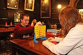 University of Chicago students took a finals study break Thursday evening to relax, play games and eat free food in the Hutchinson Commons.<br /> <br /> 08 &ndash; Chelsea Johnson and Sophia Wagner enjoy a game of Connect Four.