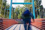 A bike rider uses a footbridge over the Clark Fork River in Missoula, Montana
